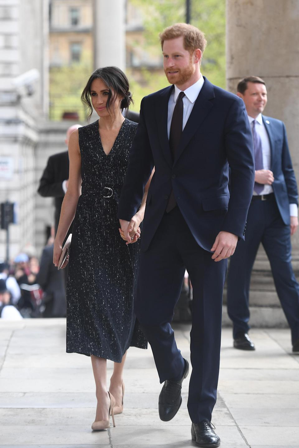 <p>Prince Harry and Meghan Markle attended a memorial service at St Martin-in-the-Fields to mark the 25th anniversary of the murder of Stephen Lawrence. For the service, the 36-year-old donned a spring-ready dress by Hugo Boss and teamed the look with her trademark messy bun. <em>[Photo: PA]</em> </p>