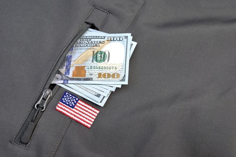 money sticking out of a pocket