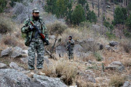 Pakistan's army soldiers guard the area, after Indian military aircrafts struck on February 26, according to Pakistani officials, in Jaba village, near Balakot, Pakistan, March 7, 2019. REUTERS/Akhtar Soomro
