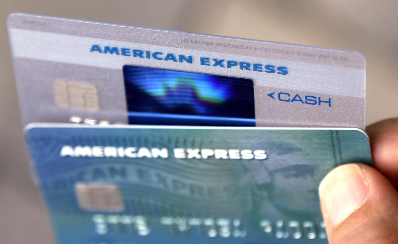 <p> FILE - In this Monday, July 18, 2016, file photo, American Express credit cards are photographed in North Andover, Mass. On Thursday, Jan. 18, 2018, American Express Co. reports financial results. (AP Photo/Elise Amendola, File) </p>