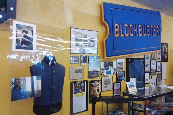 Famous movie props and costumes proudly hang on display at the back of the Blockbuster Bend store.