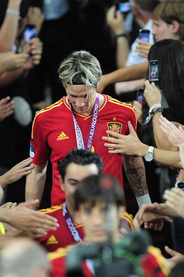 KIEV, UKRAINE - JULY 01: Fernando Torres of Spain celebrates their victory after the UEFA EURO 2012 final match between Spain and Italy at the Olympic Stadium on July 1, 2012 in Kiev, Ukraine. (Photo by Shaun Botterill/Getty Images)