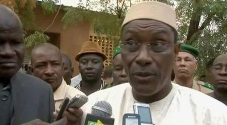 A still image taken from video shows Mali's then Defence Minister Abdoulaye Idrissa Maiga speaking to the media at Gao hospital, in Mali
