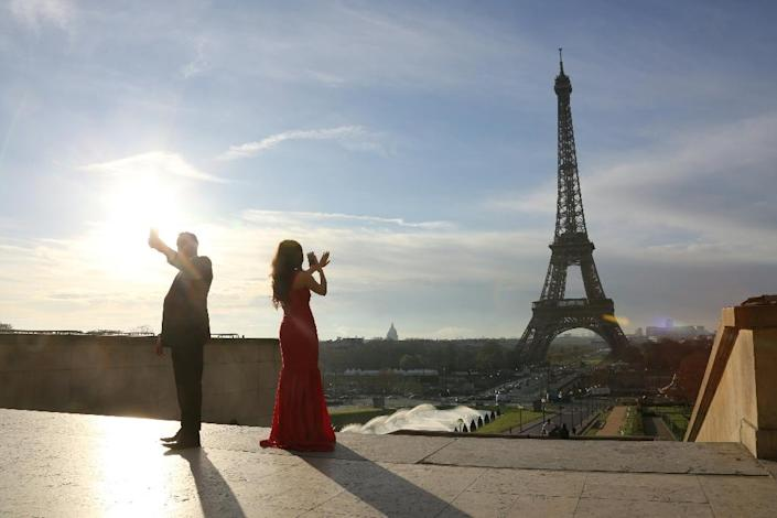 Nearly 50 fashion houses will unveil their spring and summer collections for 2017 in the French capital (AFP Photo/Ludovic Marin)