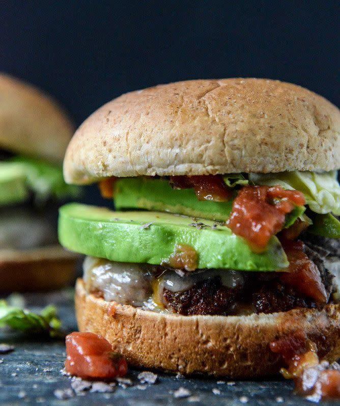 "<strong>Get the <a href=""http://www.howsweeteats.com/2013/05/taco-rubbed-burgers-with-avocado-and-crushed-tortilla-chips/"" rel=""nofollow noopener"" target=""_blank"" data-ylk=""slk:Taco Rubbed Burgers recipe"" class=""link rapid-noclick-resp"">Taco Rubbed Burgers recipe</a> from How Sweet It Is</strong>"