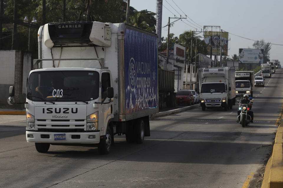 Health Ministry trucks transport COVID-19 vaccines that El Salvador's government is donating and delivering to neighboring Honduras, as they depart San Salvador, El Salvador, Thursday, May 13, 2021. (AP Photo/Salvador Melendez)