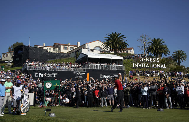 Tiger Woods tees off on the 10th hole during the final round of the Genesis Invitational golf tournament at Riviera Country Club, Sunday, Feb. 16, 2020, in the Pacific Palisades area of Los Angeles. (AP Photo/Ryan Kang)