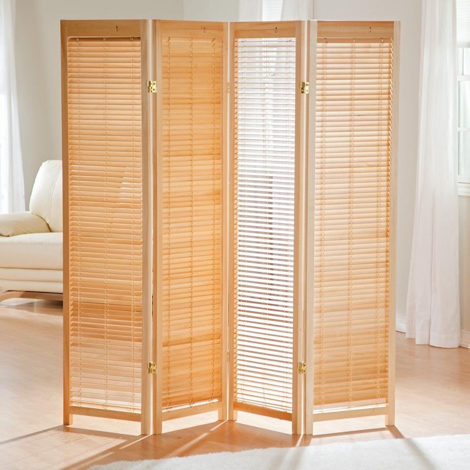 """<h3><a href=""""https://www.walmart.com/ip/Tranquility-Wooden-Shutter-Room-Divider/20384634"""" rel=""""nofollow noopener"""" target=""""_blank"""" data-ylk=""""slk:Finley Home Wooden Shutter Room Divider"""" class=""""link rapid-noclick-resp"""">Finley Home Wooden Shutter Room Divider</a> </h3><p>This four-paneled screen comes crafted with adjustable blinds for easily opening and closing off areas inside a shared space.</p><br><br><strong>Finley Home</strong> Tranquility Wooden Shutter Room Divider, $149.99, available at <a href=""""https://www.walmart.com/ip/Tranquility-Wooden-Shutter-Room-Divider/20384634"""" rel=""""nofollow noopener"""" target=""""_blank"""" data-ylk=""""slk:Walmart"""" class=""""link rapid-noclick-resp"""">Walmart</a>"""
