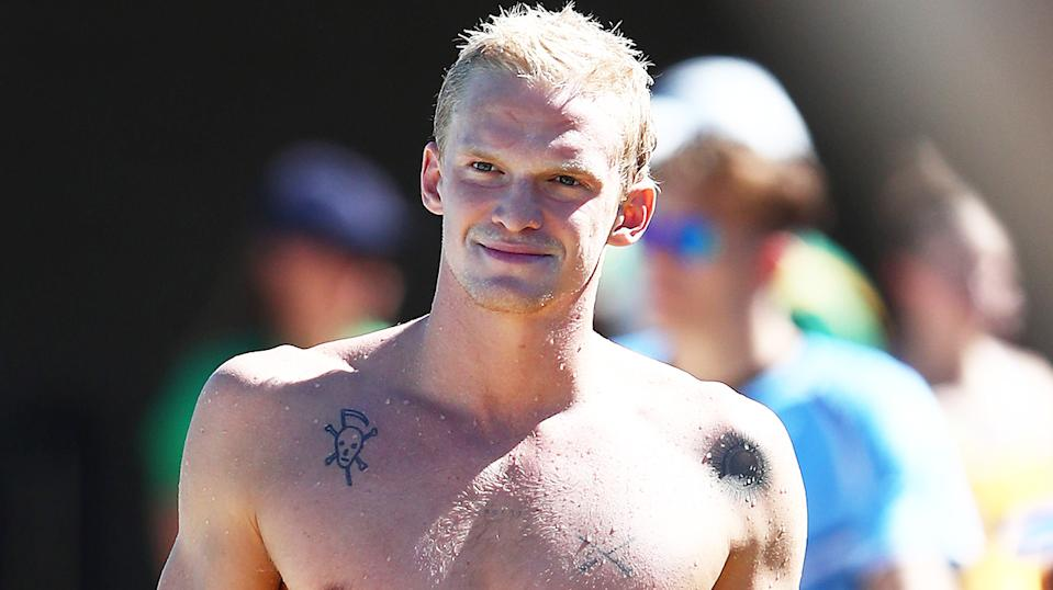 Pop star Cody Simpson (pictured) walking after leaving the pool after a training session during the 2021 Australian Swimming Championships.