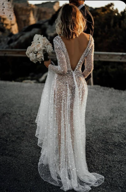 Woman wears see-through wedding gown with black thong exposed