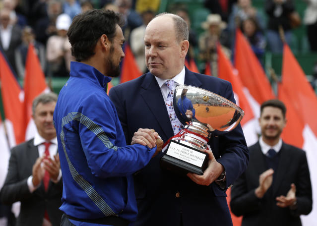 Prince Albert II of Monaco, right, hands over the trophy to Italy's Fabio Fognini, left, after his victory over Serbia's Dusan Lajovic in the men's singles final match of the Monte Carlo Tennis Masters tournament in Monaco, Sunday, April, 21, 2019. (AP Photo/Claude Paris)