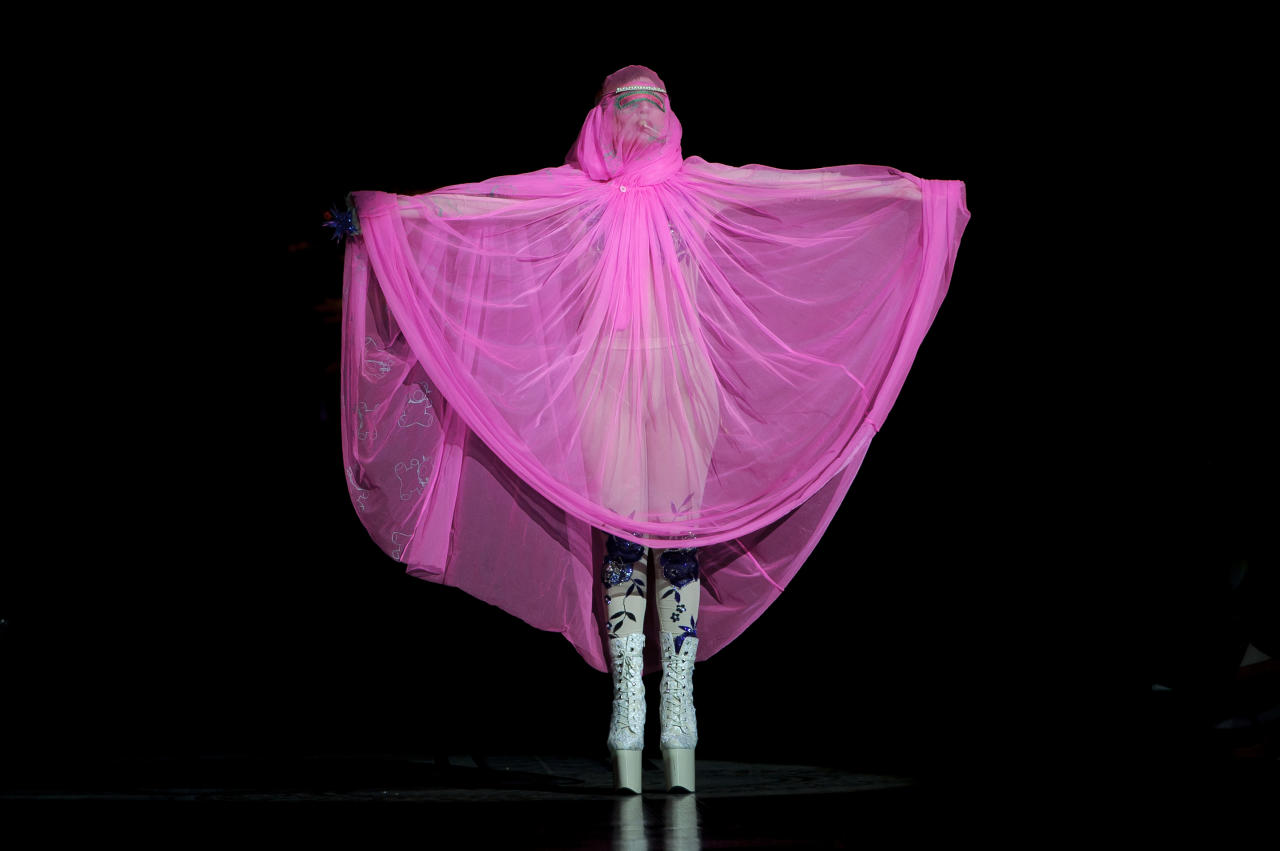 U.S singer Lady Gaga opens the Philip Treacy Spring/Summer 2013 collection during London Fashion Week, Sunday, Sept. 16, 2012. (AP Photo/Jonathan Short)