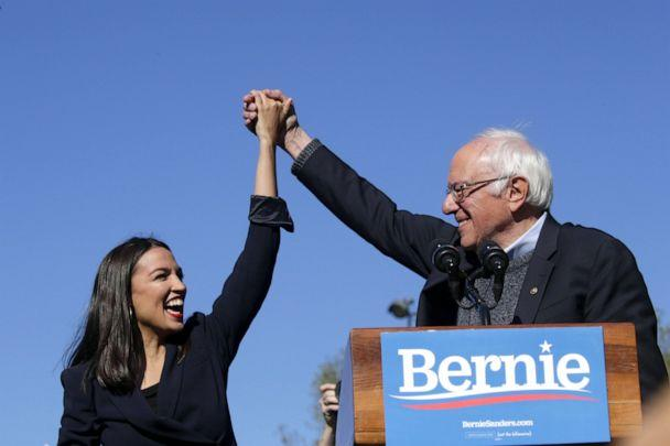 PHOTO: Democratic presidential candidate, Sen. Bernie Sanders holds hands with Rep. Alexandria Ocasio-Cortez during his speech at a campaign rally in Queensbridge Park, on October 19, 2019, in the Queens borough of New York City. (Kena Betancur/Getty Images)