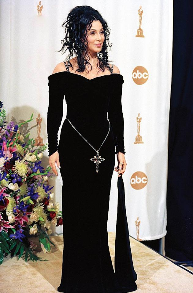 """<b>2000:</b> """"It's nice, isn't it?"""" says Cher of the black velvet Bob Mackie dress she wore to the Academy Awards. """"The gown had a train; I was holding it up. I especially like the hair. It's hard coming up with new ideas.""""  <a href=""""http://news.instyle.com/photo-gallery/?postgallery=23869?xid=omg-cher-supermodels?yahoo=yes"""" target=""""new"""">The Original Supermodels: Then and Now</a> Steve Starr/Corbis"""