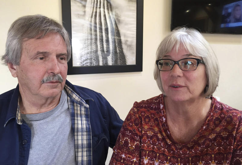 In this 2018 photo, Mark Warren and his wife Pam Warren talk about their son, Scott Daniel Warren, after Scott appeared in federal district court on a hearing to dismiss felony charges for harboring undocumented immigrants, in Tucson, Ariz. Scott Warren, a border activist charged with helping a pair of migrants with water, food and lodging, is set to go on trial on Wednesday, May 29, 2019, in U.S. court in Arizona. (Ernesto Portillo Jr./Arizona Daily Star via AP)