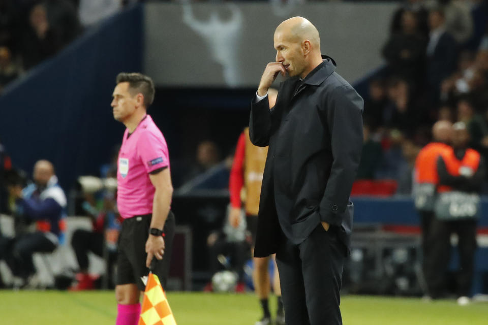 Real Madrid's head coach Zinedine Zidane reacts during the Champions League group A soccer match between PSG and Real Madrid at the Parc des Princes stadium in Paris, Wednesday, Sept. 18, 2019. (AP Photo/Francois Mori)