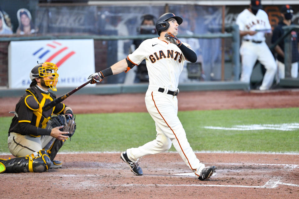 SAN FRANCISCO, CA - SEPTEMBER 25: San Francisco Giants right fielder Mike Yastrzemski (5) watches his two run home run during a MLB game between the San Diego Padres and the San Francisco Giants on September 25, 2020 at Oracle Park in San Francisco, CA. The 2020 regular season has been shortened to 60 games due to the COVID-19 Pandemic. (Photo by Brian Rothmuller/Icon Sportswire via Getty Images)