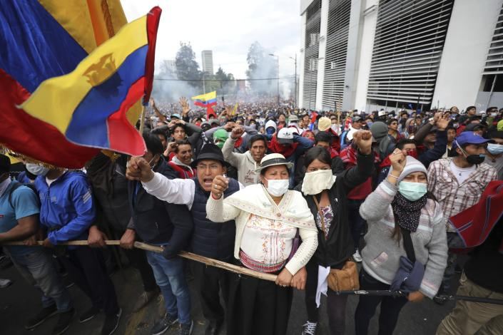 Anti-government demonstrators chant slogans against President Lenin Moreno and his economic policies during a protest in Quito, Ecuador, Tuesday, Oct. 8, 2019. The protests, which began when Moreno's decision to cut subsidies led to a sharp increase in fuel prices, have persisted for days and clashes led the president to move his besieged administration out of Quito. (AP Photo/Fernando Vergara)