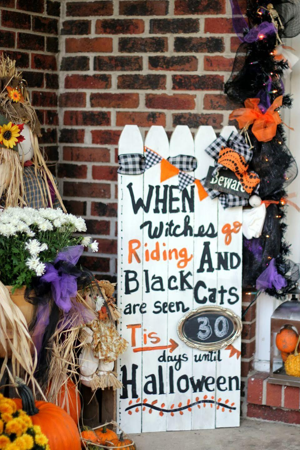 """<p>Made from picket fence pieces, this Halloween countdown sign is the perfect way to drum up excitement for the holiday. Use chalkboard paint where your numbers will go, so you can update it each day. </p><p><strong>Get the tutorial at <a href=""""http://priscillas2000.blogspot.ca/2013/10/picket-fence-halloween-countdown.html"""" rel=""""nofollow noopener"""" target=""""_blank"""" data-ylk=""""slk:Priscillas"""" class=""""link rapid-noclick-resp"""">Priscillas</a>.</strong> </p>"""