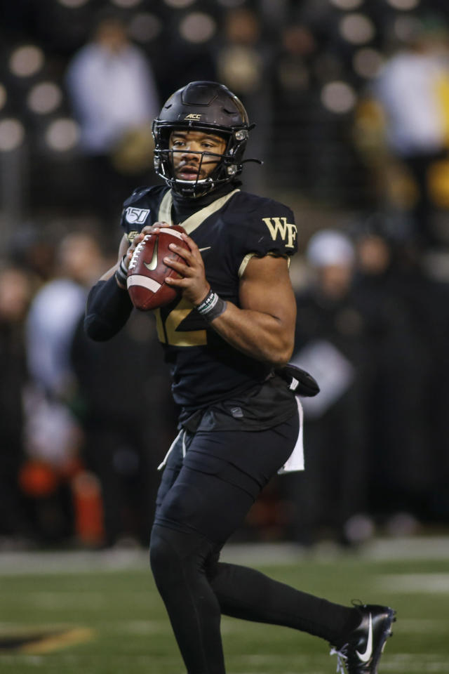 Wake Forest quarterback Jamie Newman looks to pass against Duke in the second half of an NCAA college football game in Winston-Salem, N.C., Saturday, Nov. 23, 2019. Wake Forest won 39-27. (AP Photo/Nell Redmond)
