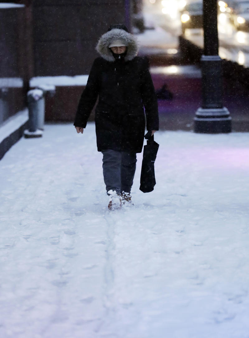 A man walks on a sidewalk in downtown Chicago, Saturday, Jan. 12, 2019. A winter weather advisory is in effect until 3 a.m. Sunday and covers northern Illinois and Northwest Indiana including Lee, DeKalb, Kane, DuPage and Cook counties. (AP Photo/Nam Y. Huh)