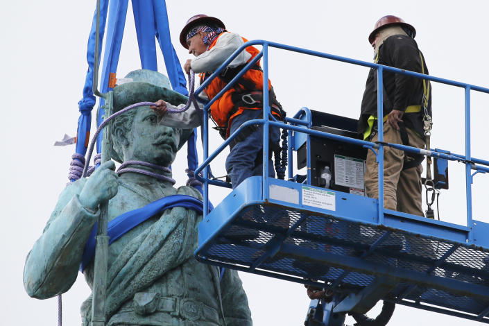 Crews work to remove the Confederate Soldiers & Sailors Monument in Libby Hill Park, Wednesday, July 8, 2020, in Richmond, Va. The 17 ft statue stands on a 73 foot pedestal overlooking downtown. The statue is one of several that will be removed by the city as part of the Black Lives Matter reaction. (AP Photo/Steve Helber)