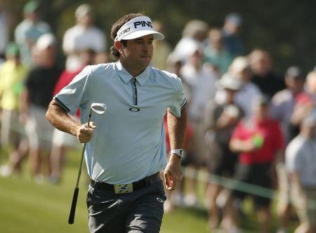 Bubba Watson of the U.S. makes his way up onto the third green during first round play of the Masters golf tournament at the Augusta National Golf Course in Augusta, Georgia April 9, 2015. REUTERS/Phil Noble