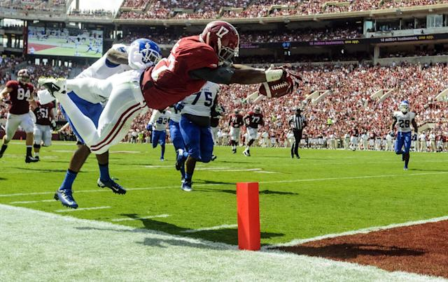 Alabama running back Kenyan Drake (17) dives over the goal line past Georgia State cornerback Demarius Matthews, left, for a touchdown in the first half of an NCAA college football game on Saturday, Oct. 5, 2013, in Tuscaloosa, Ala. (AP Photo/AL.com Vasha Hunt)
