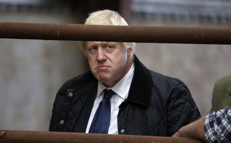 Britain's Prime Minister Boris Johnson visits Darnford Farm in Banchory near Aberdeen, Scotland, Friday Sept. 6, 2019, to coincide with the publication of Lord Bew's review and an announcement of extra funding for Scottish farmers. (Andrew Milligan/PA via AP)