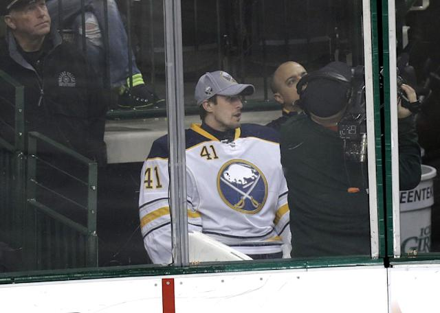 Buffalo Sabres goalie Jaroslav Halak (41) watches play from behinds the glass during the second period of an NHL hockey game against the Dallas Stars Monday, March 3, 2014, in Dallas. (AP Photo/LM Otero)