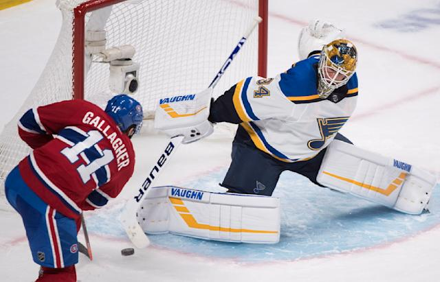 Montreal Canadiens' Brendan Gallagher scores against St. Louis Blues goaltender Jake Allen during the third period of an NHL hockey game, in Montreal, Wednesday, Oct. 17, 2018. (Graham Hughes/The Canadian Press via AP)