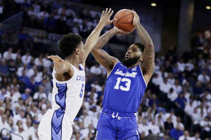 Seton Hall's Myles Powell (13) shoots against Creighton's Ty-Shon Alexander (5) during the first half of an NCAA college basketball game in Omaha, Neb., Saturday, March 7, 2020. (AP Photo/Nati Harnik)