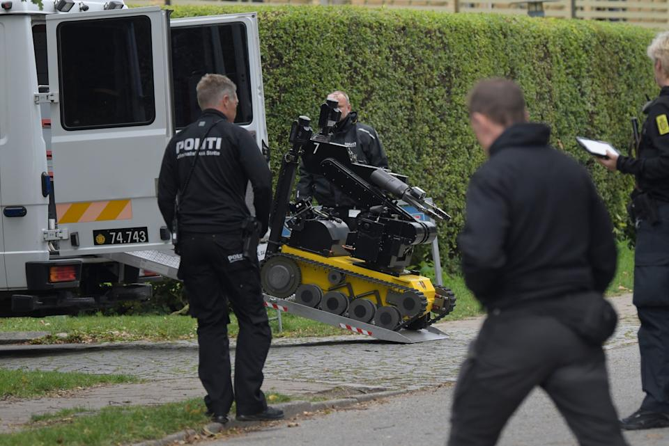 Police are at the scene and have brought a bomb-defusing robot amid reports the escapee has explosives on his person (Photo: NILS MEILVANG via Getty Images)