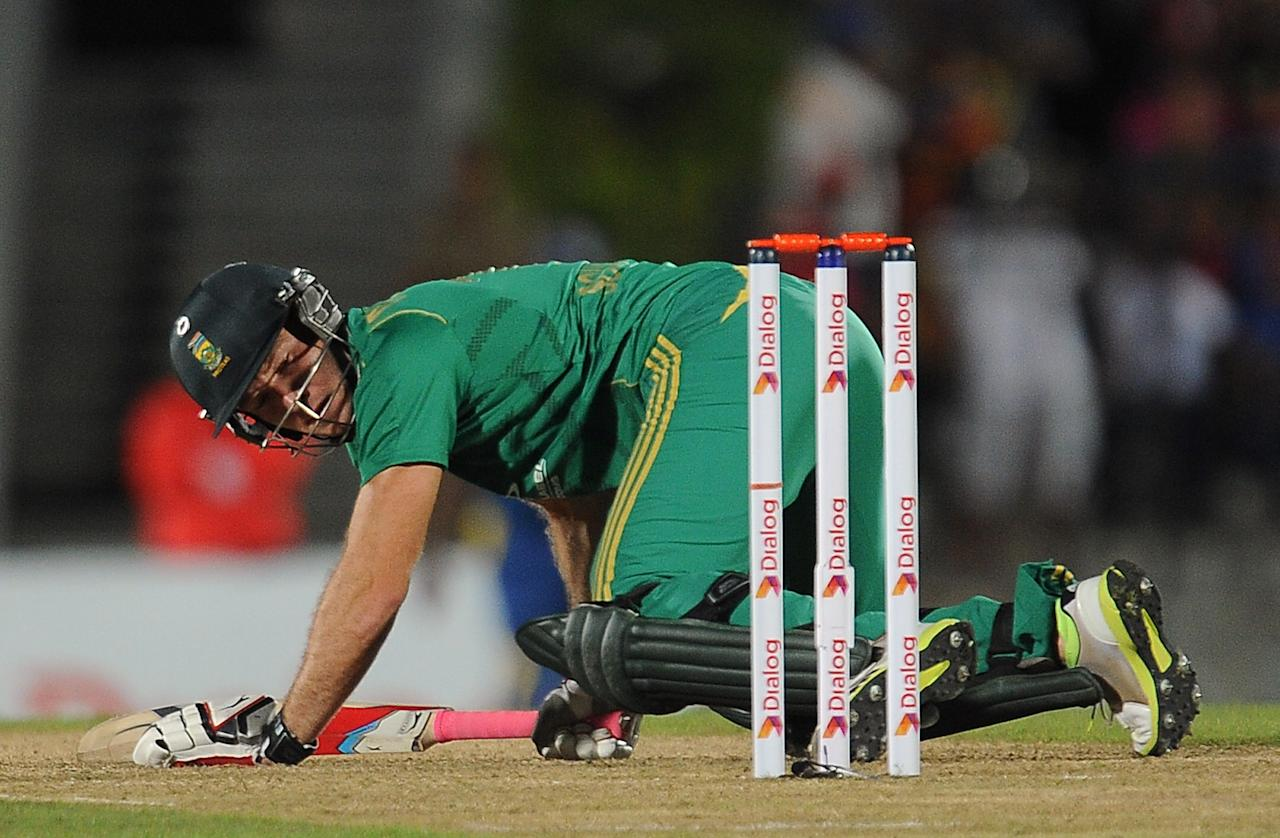 South African batsman David Miller looks back during the second Twenty20 cricket match between Sri Lanka and South Africa at the Suriyawewa Mahinda Rajapakse International Cricket Stadium in the southern district of Hambantota on August 4,2013. AFP PHOTO / LAKRUWAN WANNIARACHCHI