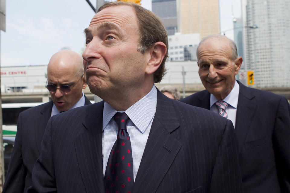 FILE - In this Aug. 15, 2012, file photo, National Hockey League commissioner Gary Bettman arrives for collective bargaining talks in Toronto. The National Hockey League Players' Association announces its decision whether to terminate the current collective bargaining agreement and set the clock ticking toward another potential work stoppage in 2020. (AP Photo/The Canadian Press, Chris Young, File)