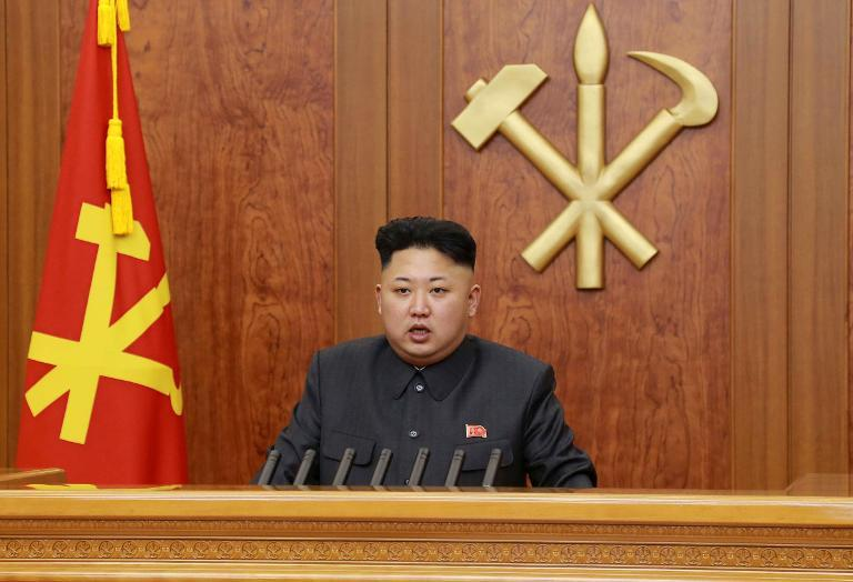 KCNA handout photo taken on January 1, 2014 shows North Korean leader Kim Jong-Un delivering his New Year's Day address in Pyongyang