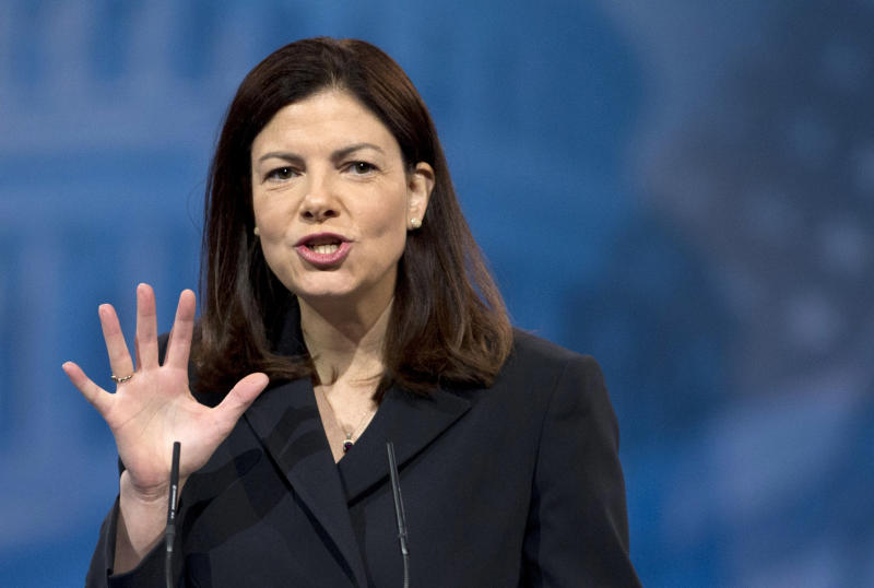"""FILE - In this March 15, 2013, file photo Sen. Kelly Ayotte, R-N.H., speaks at the Conservative Political Action Conference in National Harbor, Md. On a Sunday morning talk show June 9, 2013, Ayotte said she will back the bipartisan overhaul of the nation's immigration system. She said the immigration system is broken and needs to be fixed, and that the Senate proposal secures the border and provides a """"tough but fair"""" way for immigrants to earn citizenship. (AP Photo/Manuel Balce Ceneta, File)"""
