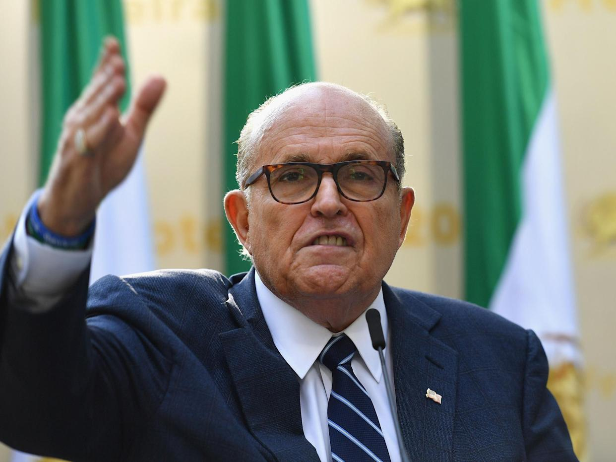 Mr Trump told reporters he didn't know if Rudy Giuliani (pictured) was still his personal attorney: Angela Weiss/AFP/Getty Images