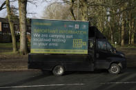 An information board is displayed where distributors were going house-to-house giving resident home testing kits for COVID-19 from Britain's Department of Health, in Woking, England, Tuesday, Feb. 2, 2021, during England's third national lockdown since the coronavirus outbreak began. British health authorities plan to test tens of thousands of people in a handful of areas of England, including parts of Woking, in an attempt to stop a new variant of the coronavirus first identified in South Africa spreading in the community. The Department of Health says a small number of people in England who had not travelled abroad have tested positive for the strain. (AP Photo/Matt Dunham)