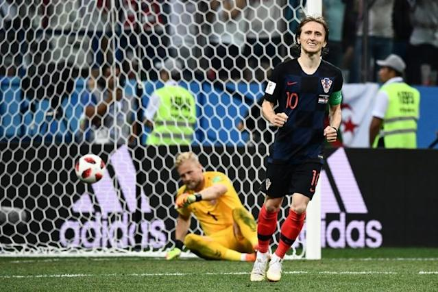 Croatia's midfielder Luka Modric celebrates after scoring in the penalty shootout during their Russia 2018 World Cup round of 16 match against Denmark, in Nizhny Novgorod, on July 1