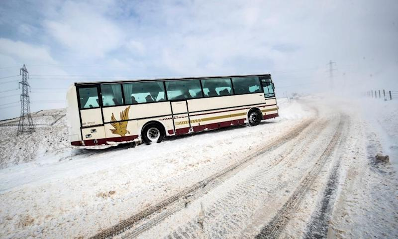A stranded coach on Blackstone Edge near Littleborough in Greater Manchester.