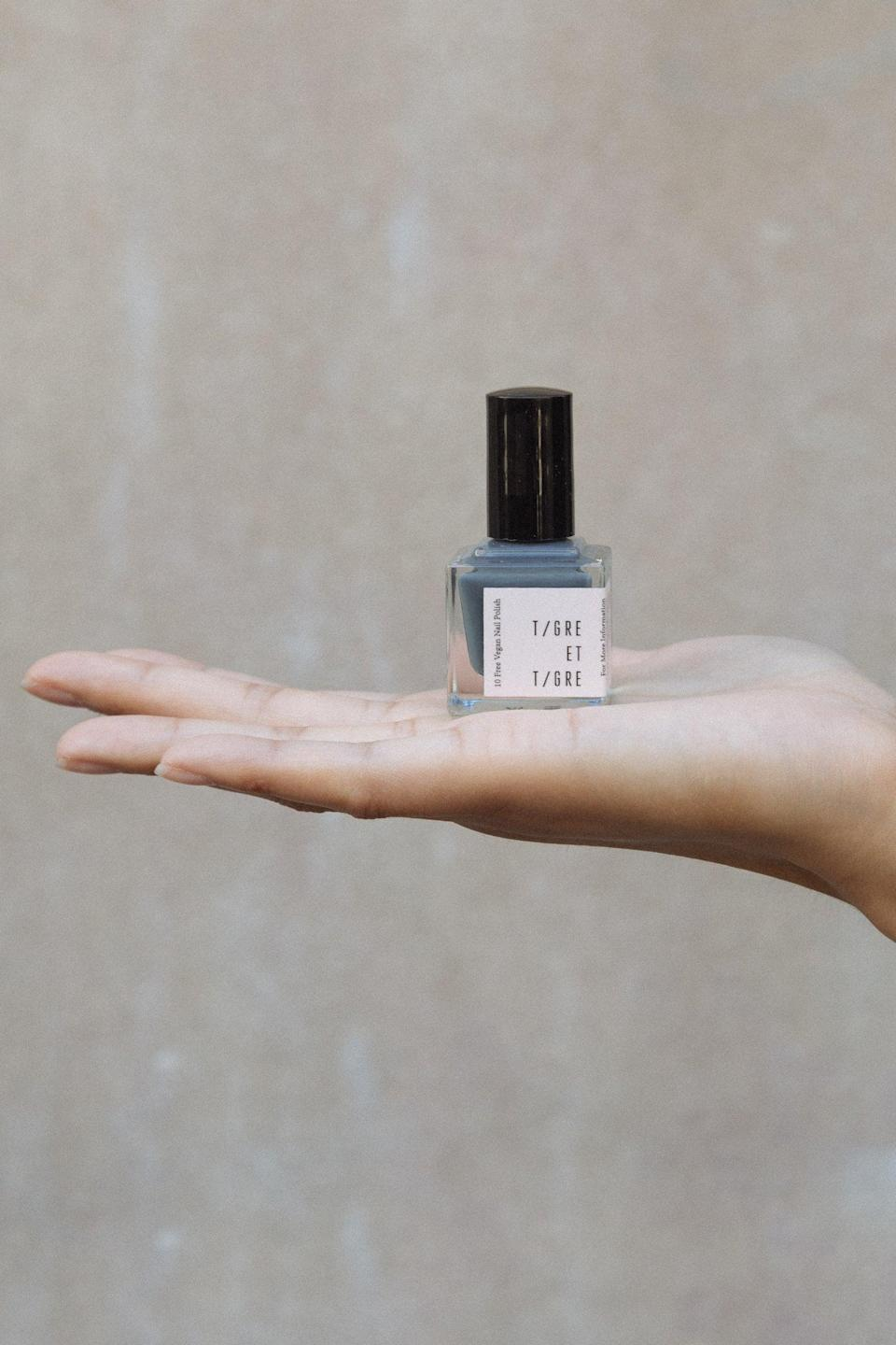 "To an untrained eye, this might look like an aesthetically pleasing bottle of $20 nail polish. But to your fashion friend, it's actually a vegan, 10-free bottle of $20 nail polish created by one of 2020's most-beloved indie brands. They'll love it. <br><br><strong>Tigre et Tigre</strong> Nail Polish | Buckets of Rain, $, available at <a href=""https://go.skimresources.com/?id=30283X879131&url=https%3A%2F%2Ftigreettigre.com%2Fcollections%2Fnail-polish%2Fproducts%2Fnail-polish-buckets-of-rain"" rel=""nofollow noopener"" target=""_blank"" data-ylk=""slk:Tigre et Tigre"" class=""link rapid-noclick-resp"">Tigre et Tigre</a>"