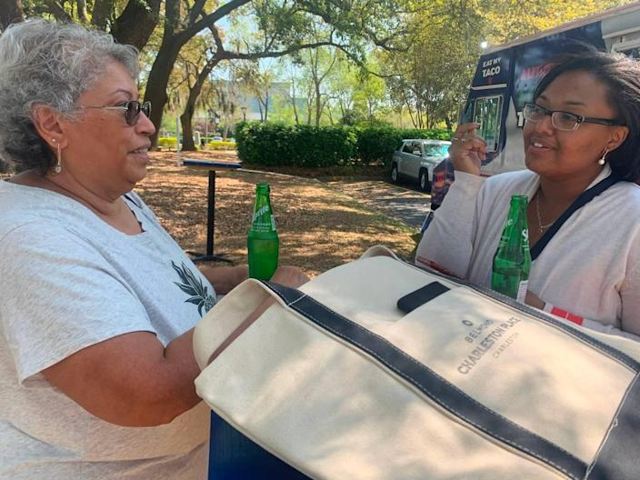 """Luz Espada, left, discusses pros and cons with her granddaughter, Briana Hurdle, after the pair attended a job fair for hospitality industry on Wednesday, April 7, 2021 . """"Some of these places are offering bonuses,"""" Espada said of Charleston hotels. """"There's a lot to consider."""" Caitlin Byrd/The State"""