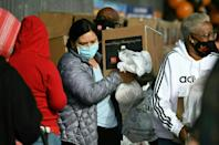 Residents hit financially by the pandemic receive Thanksgiving meal boxes at in Los Angeles, California, on November 20, 2020