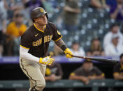 San Diego Padres' Manny Machado flies out against Colorado Rockies starting pitcher Austin Gomber in the fourth inning of a baseball game Monday, June 14, 2021, in Denver. (AP Photo/David Zalubowski)