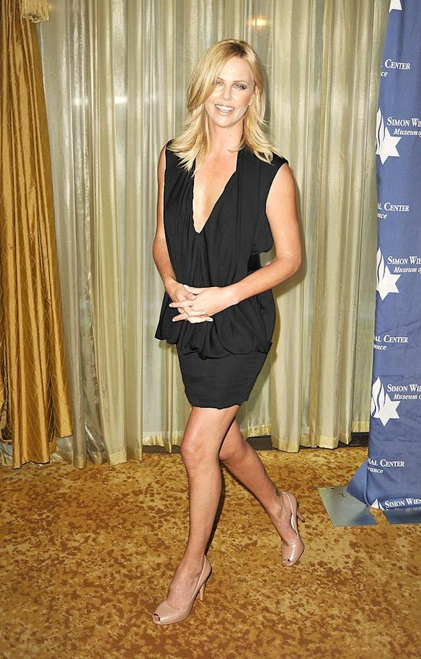 "Charlize Theron shows off her gorgeous gams upon arriving at a charity dinner at the Beverly Wilshire Hotel in Beverly Hills, CA. Kevin Winter/<a href=""http://www.gettyimages.com/"" target=""new"">GettyImages.com</a> - May 5, 2009"