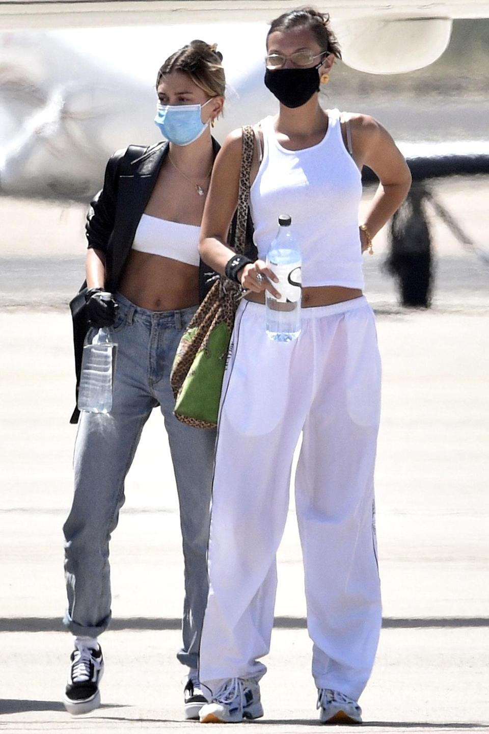 <p>Bella Hadid and Hailey Baldwin catch a flight home from Italy together on Saturday following a photo shoot abroad.</p>