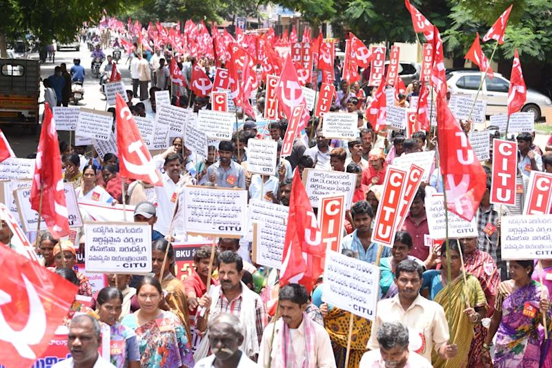 Millions of workers strike in India over reforms, wages