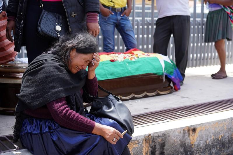 A woman reacts near the coffin of a supporter of former Bolivian President Morales in Cochabamba
