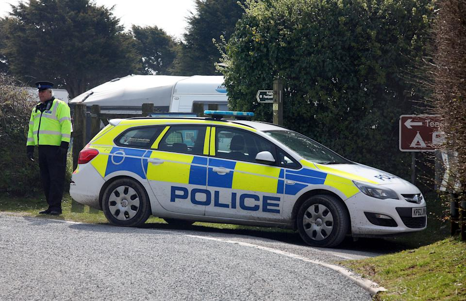 Police outside Tencreek Holiday Park, Looe, Cornwall where nine-year-old Frankie MacRitchie was mauled to death by a dog.